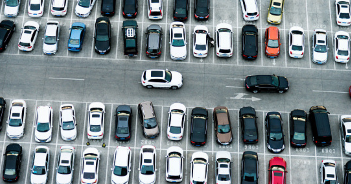 cars parked in a well-pave parking lot