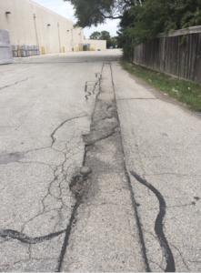 asphalt safety hazard before photo