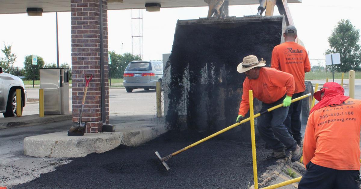 preventative maintenance crew laying asphalt