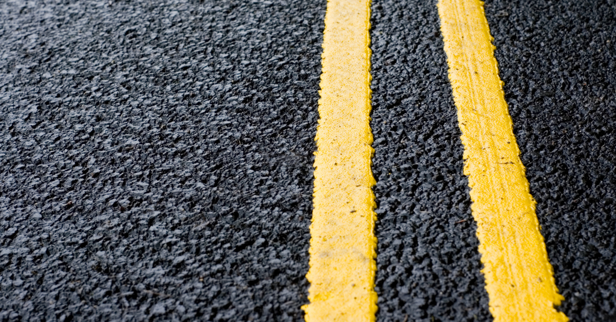 Yellow stripes on fresh asphalt