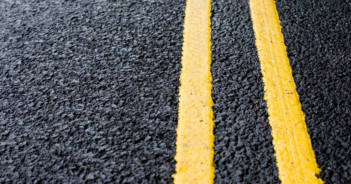 Yellow stripes on fresh asphalt