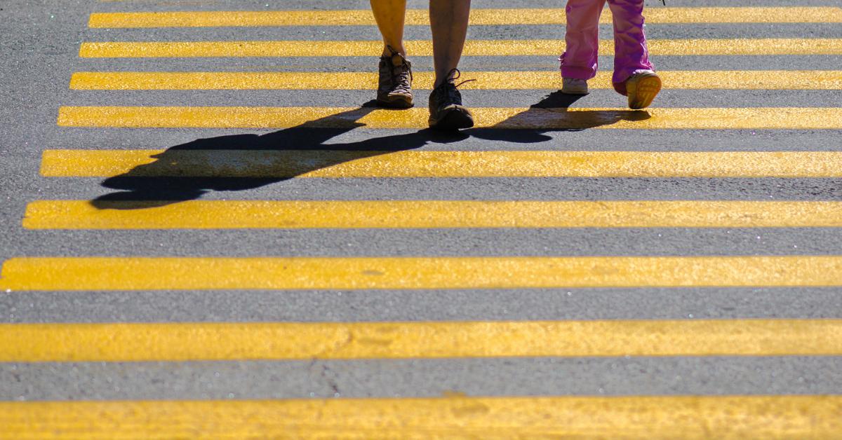 kids walking across newly paved crosswalk