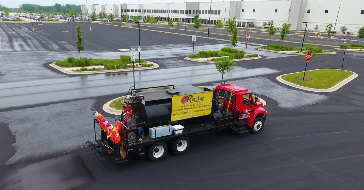 Rose Paving truck on fresh asphalt